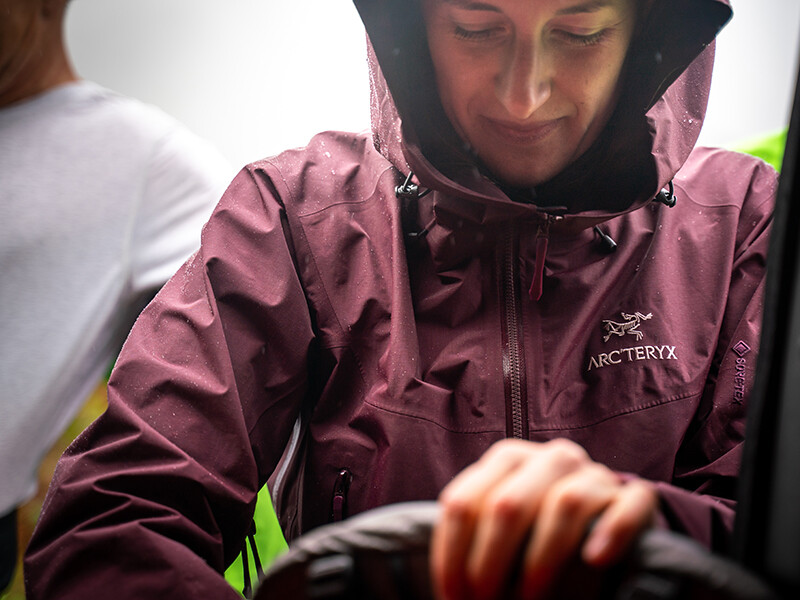 Woman wearing Arc'teryx waterproof preparing for day out walking
