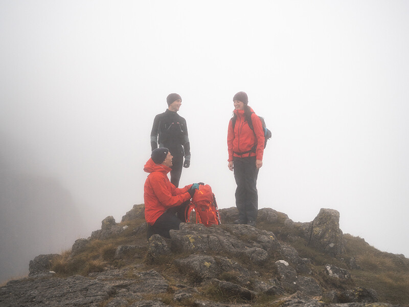 3 Hikers looking happy in heavy fog