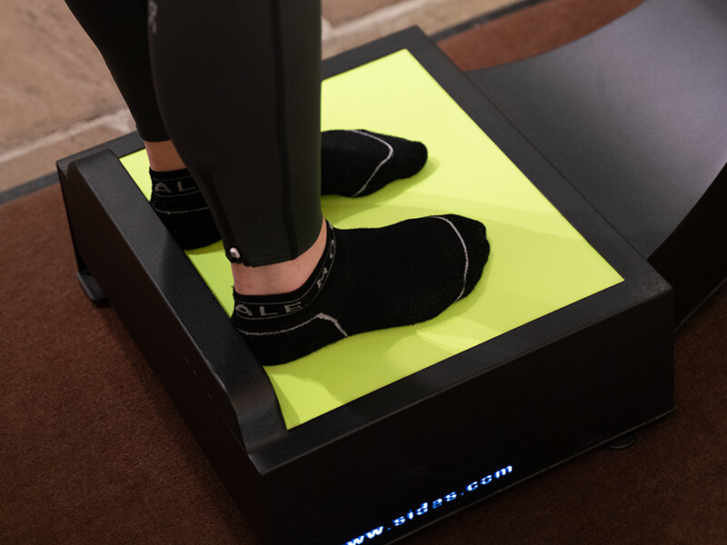 Standing on a Sidas foot measurement machine