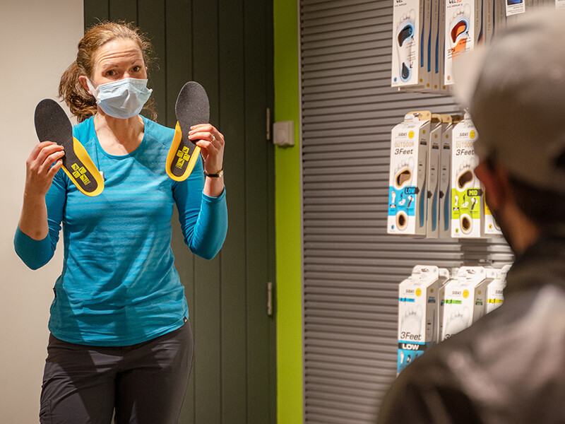 Shop staff demonstrating insoles